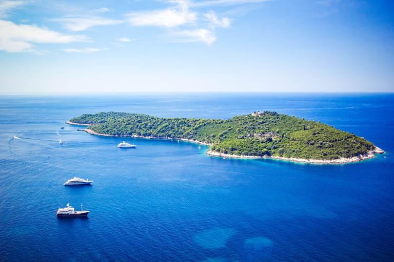 Panoramic view of Lokrum Island Dalmatian Coast of Adriatic Sea in Dubrovnik. Blue sea with white yachts, beautiful landscape, aerial view, Dubrovnik, Croatia.