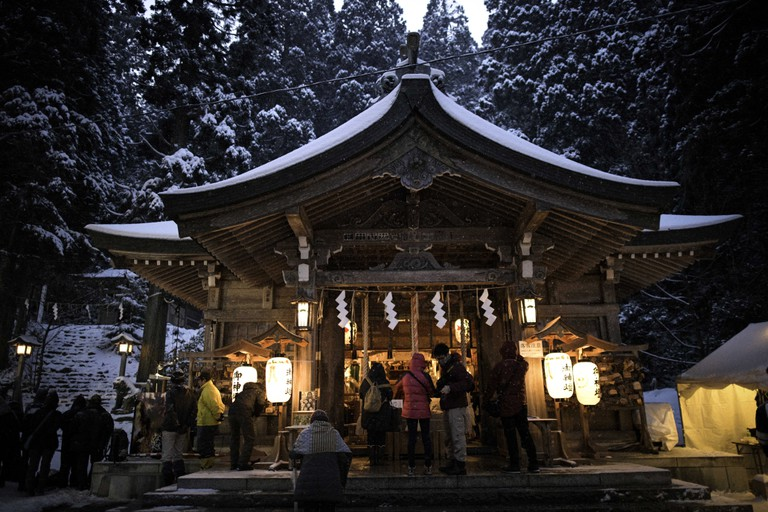 People offer prayer at the shrine during the Namahage Sedo Festival at Shinzan Shrine in Oga