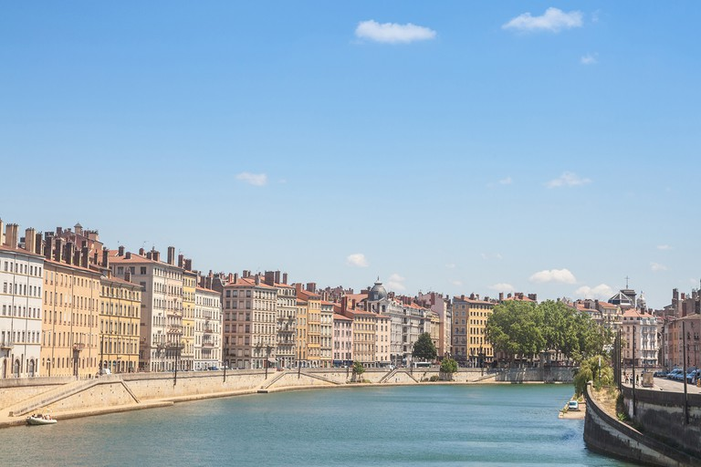 Panorama of Saone river and the Quais de Saone riverbank and riverside in the city center of Lyon, with a focus on the old building facades of the Presqu'Ile.