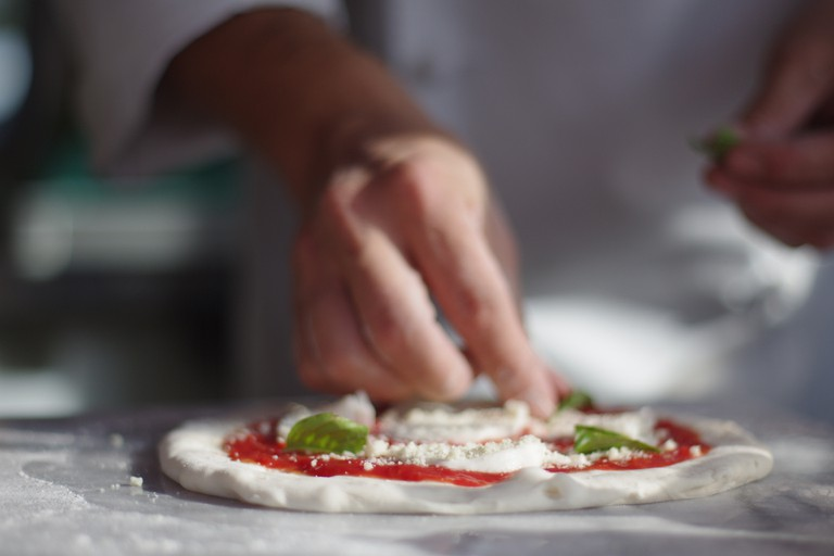 Chef Making Pizza at an Italian restaurant