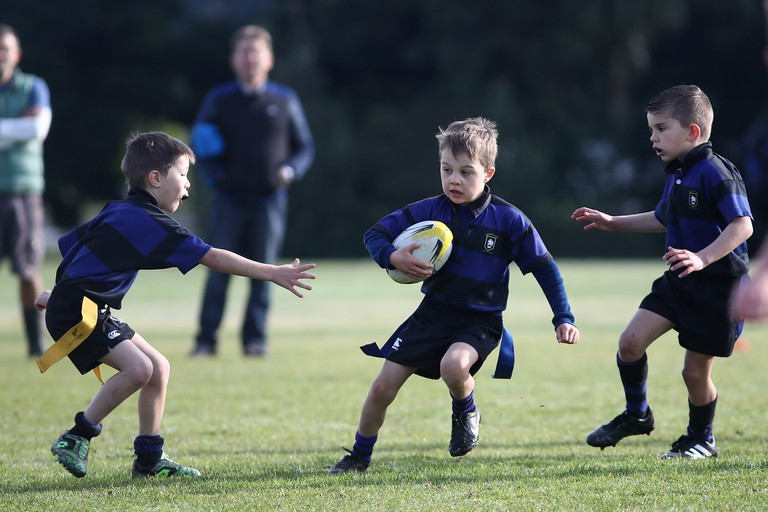 Children play rugby in Auckland