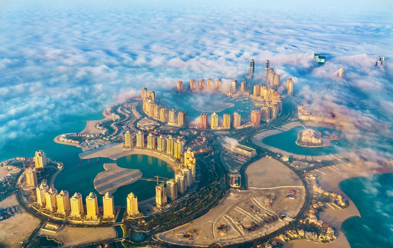 Aerial view of the Pearl-Qatar island in Doha through the morning fog - Qatar, the Persian Gulf