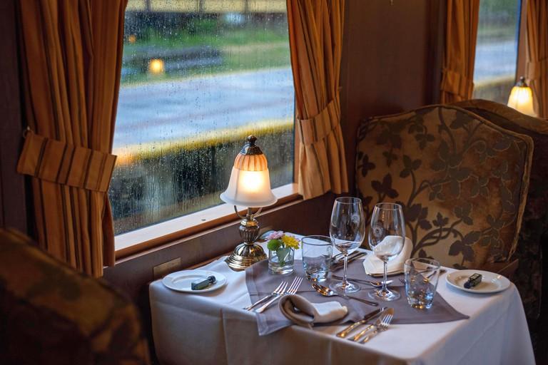 Inside of Transcantabrico Gran Lujo luxury train travellong across northern Spain, Europe. Interior of restaurant car.
