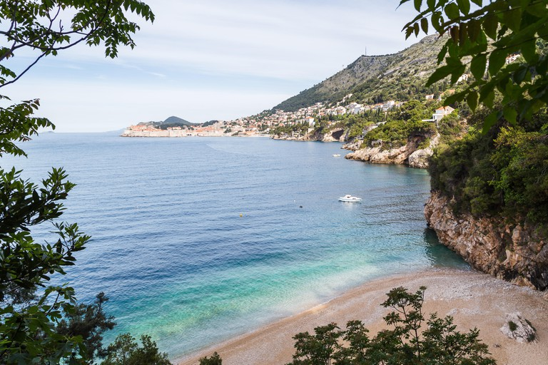 Sveti Jakov, a secluded beach sandwiched between the rocks facing the town of Dubrovnik