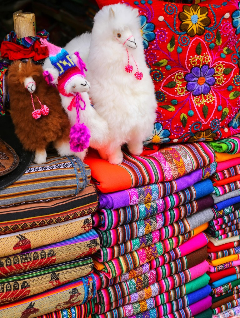 Display of traditional textiles at a market in Lima