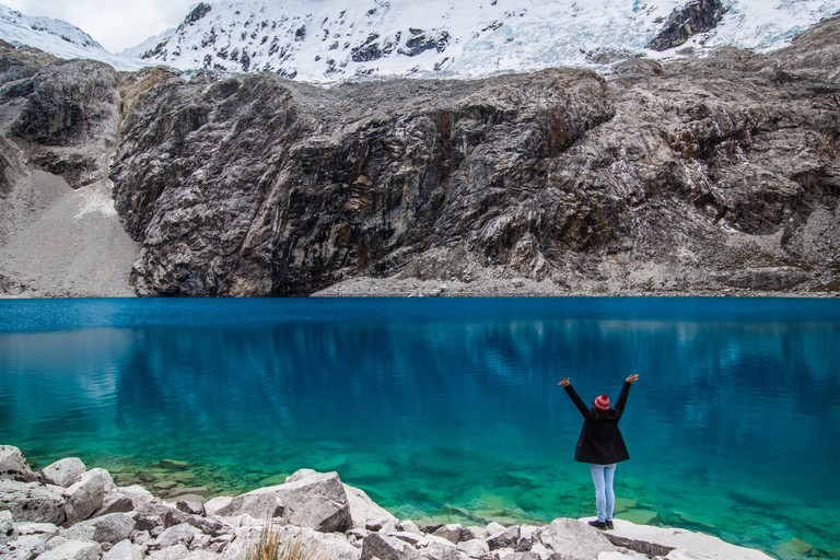 Girl at Laguna 69 with outstretched arms taking in the beautiful landscape!