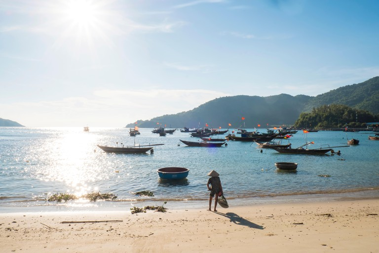fishing boats off the beach on the Cham Islands in Vietnam