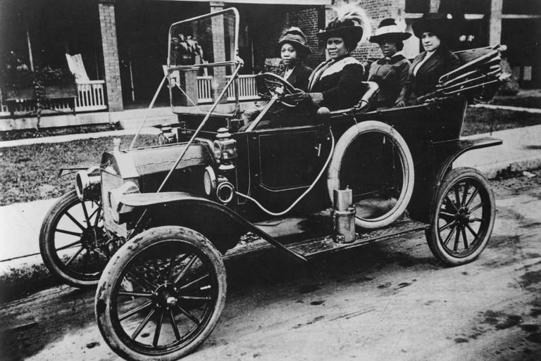 A photograph of Sarah Breedlove driving a car, she was better known as Madam C.J. Walker, she was the first woman to become a self-made millionaire in the United States, she built a highly successful line of beauty and hair products for black women, she w