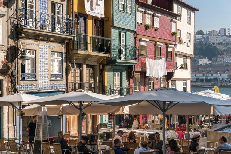 Cafe bars and traditional old, tiled houses on the waterfront in the Ribeira district of Porto, Portugal