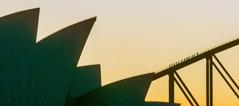 Tourist take part in a Bridgeclimb over Sydney Harbour Bridge