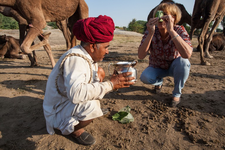 German-born vet, Ilse Koller Rollefson drinking camel milk, which is packed with nutrients