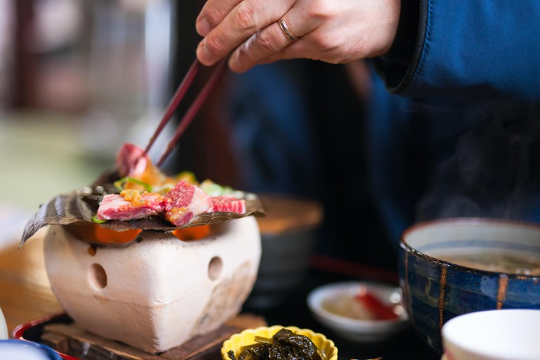 Traditional Japanese lunch with hida beef prepared on grill