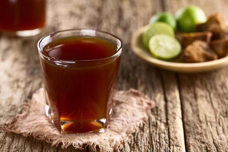 Fresh homemade Aguapanela, Agua de Panela or Aguadulce, a popular Latin American sweet drink made of panela unrefined whole cane sugar boiled in water