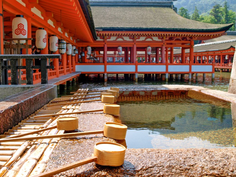 Mirrored pond at Itsukushima shrine