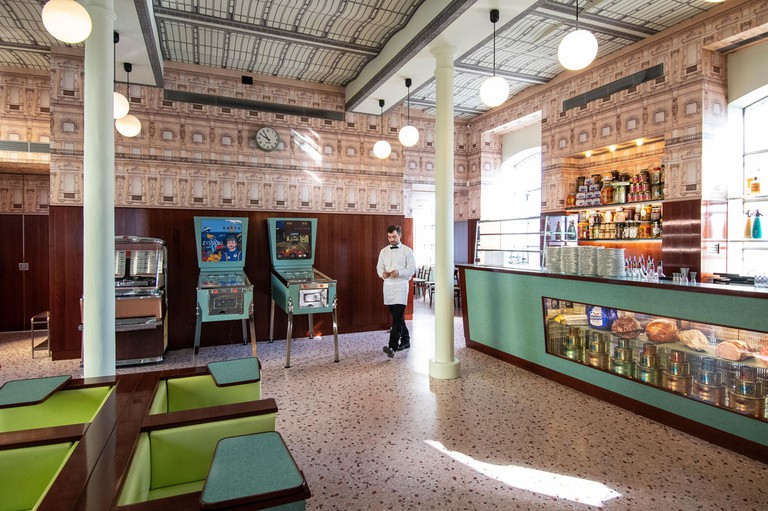 Retro-looking interiors and formica pastel furniture at Bar Luce, Wes Anderson-inspired bar and cafe in the Fondazione Prada district of Milan, Italy