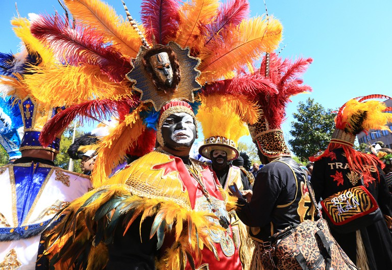 Members of the Krewe of Zulu perform on Basin Street in Treme during Mardi Gras in New Orleans.