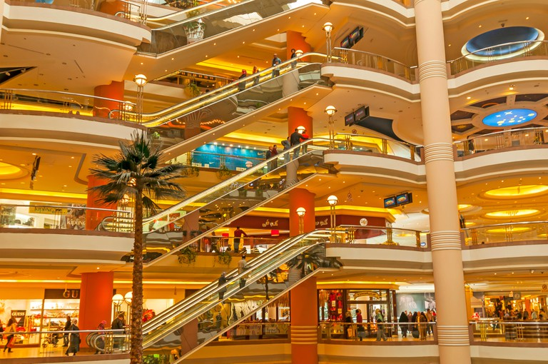 Atrium of City Stars Mall Heliopolis showing multi-levels, elevators and palm tree indoors Heliopolis Cairo Egypt