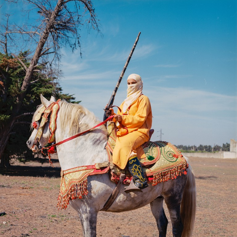 Bouchra on her Arab Berber horse is the chief of the troop Al Farisat Hawziya in Rabat, one of the few female troops who practice Fantasia in Morocco. Bouchra is an experienced rider who learned Fantasia with her grandfather who was himself a chief of a male troop