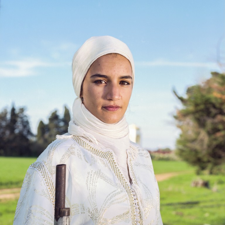 Shaimaie, 19, is a member of the female troop Farisat El Hawzia