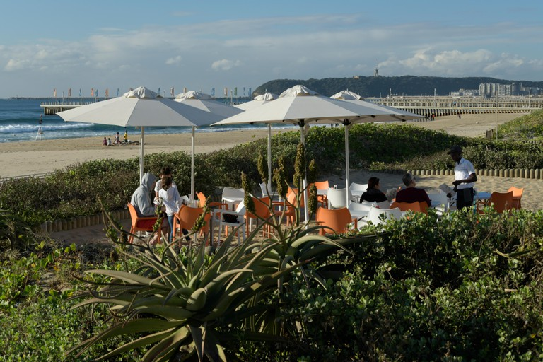 People enjoying breakfast at a beach cafe