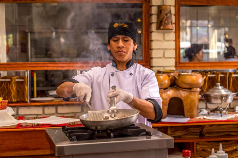 Cuzco, Peru - May 3, 2019. A Peruvian Chef demostrate cooking in Cuzco peru