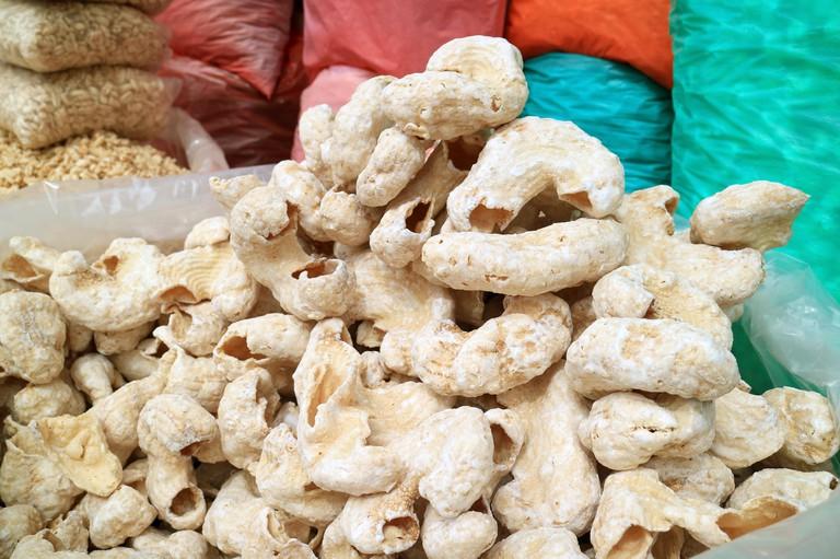 Pile of Bolivian Crispy Corn Snacks at the Local Market of Copacabana, Bolivia, South America