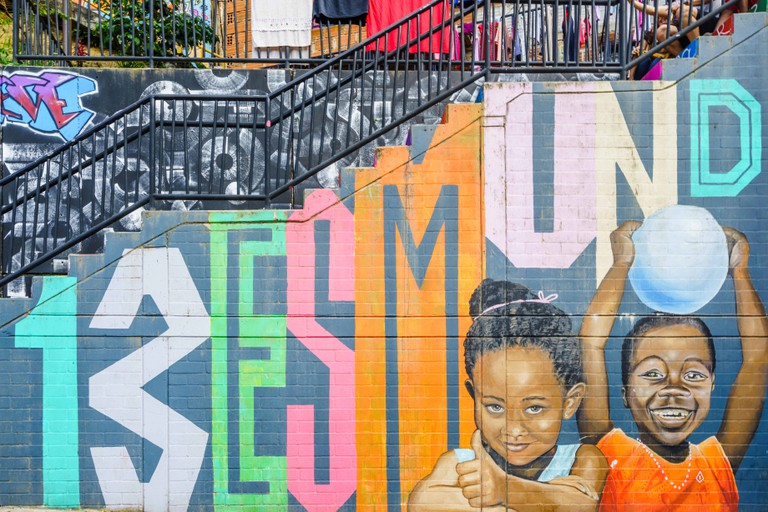 Street art graffiti on a wall in the street of Medellin, Colombia - March 16, 2019