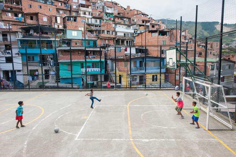 Kids playing soccer in Comuna 13, Medellin, Colombia.