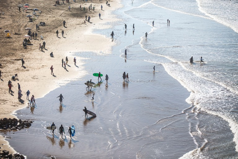 Surfers at the beach in Rabat