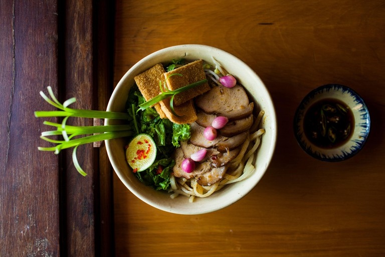 A bowl of Cao lau noodles, a specialty dish with noodles made from local well water in Hoi An
