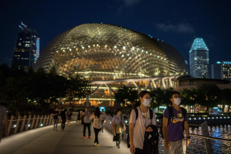 February 12, 2020, Singapore, Singapore: People wearing protective surgical masks walk towards the Merlion Park, a major tourist attraction in Singapore..Singapore declared the Coronavirus outbreak alert as Code Orange on February 7, 2020. (Credit Image: