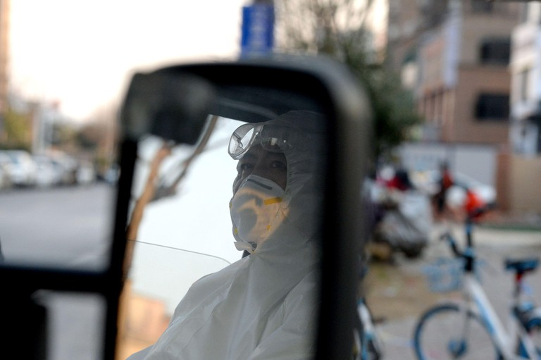 (200213) -- BENGBU(ANHUI), Feb. 13, 2020 (Xinhua) -- Chen Xiaoliang waits for patients on the ambulance in Bengbu, east China's Anhui Province, Feb. 12, 2020. Chen Xiaoliang is an ambulance driver at the emergency aid center in Bengbu. He volunteered to t