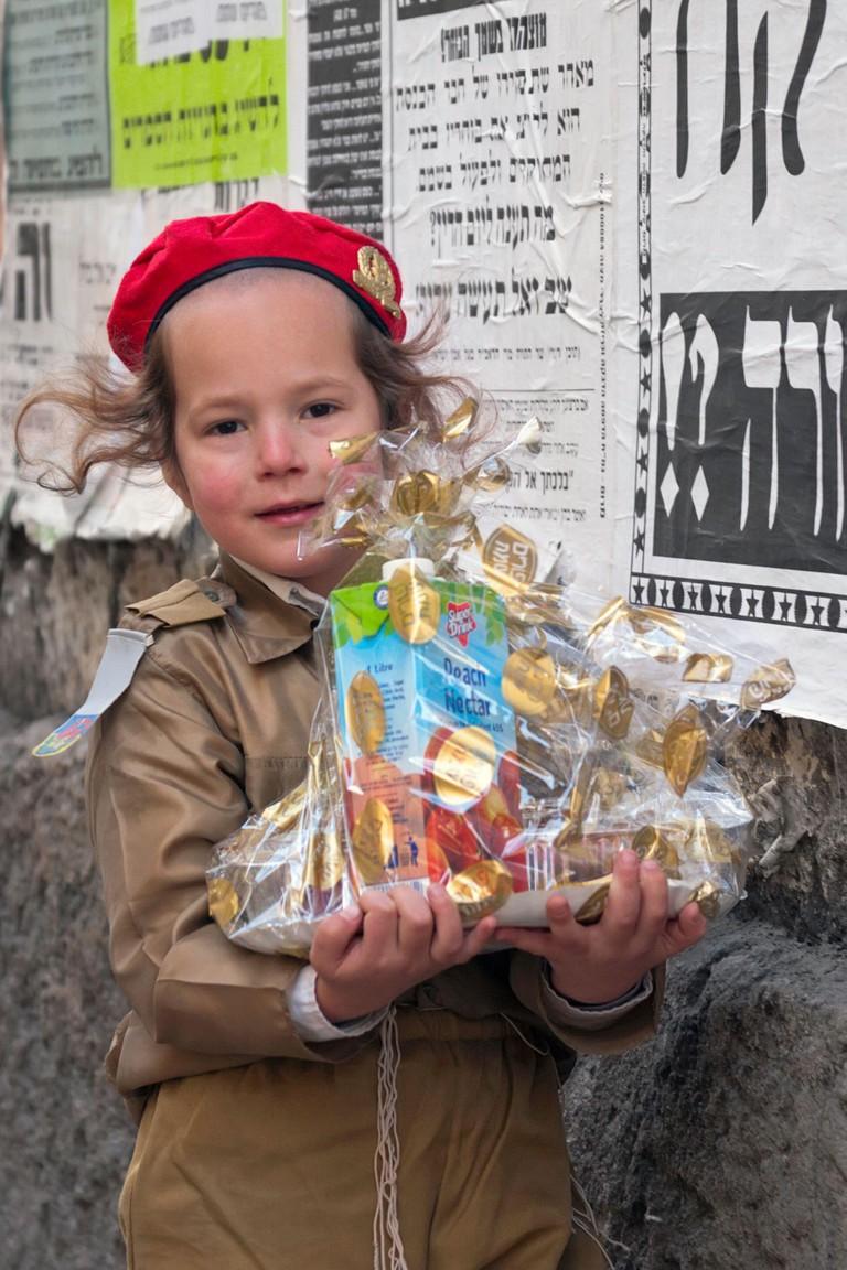 JERUSALEM, ISRAEL - MARCH 15, 2006: Purim carnival in the famous ultra-orthodox quarter of Jerusalem - Mea Shearim. Portrait of a boy children