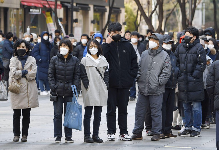 People line up for masks in Seoul, amid the spread of the coronavirus