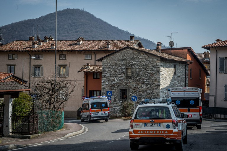 Nembro medical personnel takes a suspected coronavirus case to hospital in ambulances, Nembro, Italy