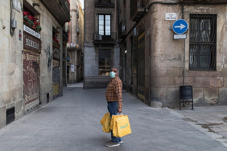 A glovo rider delivering food near the city hall of Barcelona, ????in the middle of the coronavirus crisis. People have been officially confined since