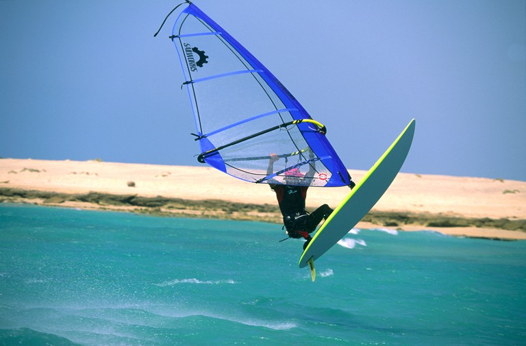 aerial jump by single male windsurfer at Ras Sudr Red Sea Sinai Egypt