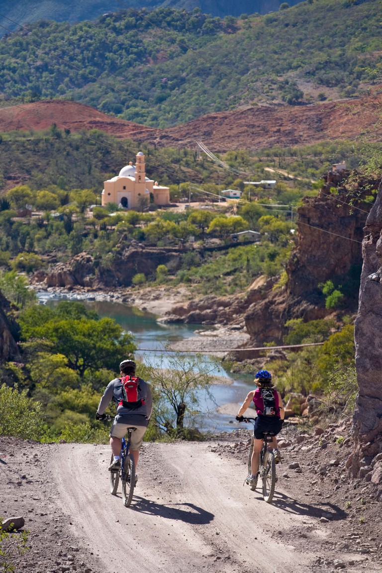Dan and Alida Dierher mountain biking from Batopilas to the Lost Cathedral of Satevo in the Copper Canyon area Mexico. Image shot 2008. Exact date unknown.