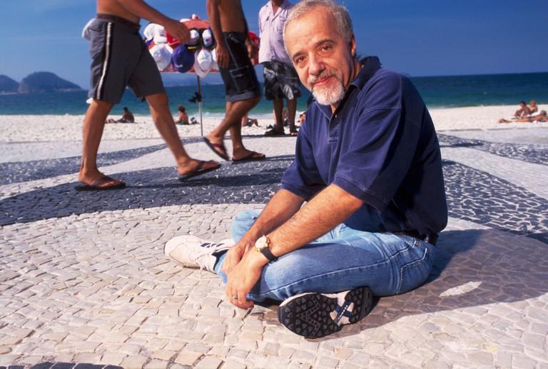 Brazilian writer Paulo Coelho at Ipanema s beach sidewalk Rio de Janeiro Brazil 11 01 02