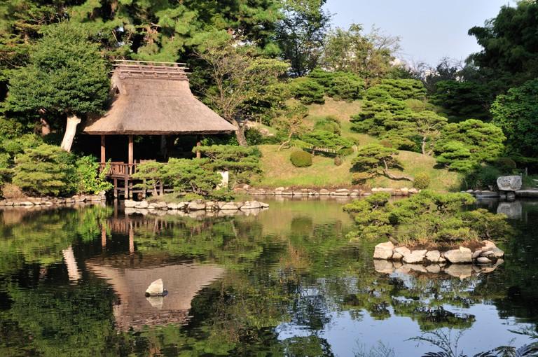 Pagoda at the water's edge at Shukkeien garden, Hiroshima.