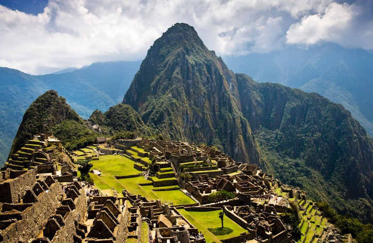 Classic view of Machu Picchu showing the ancient Incan site with Wayna Picchu or Huayna Picchu behind Peru South America