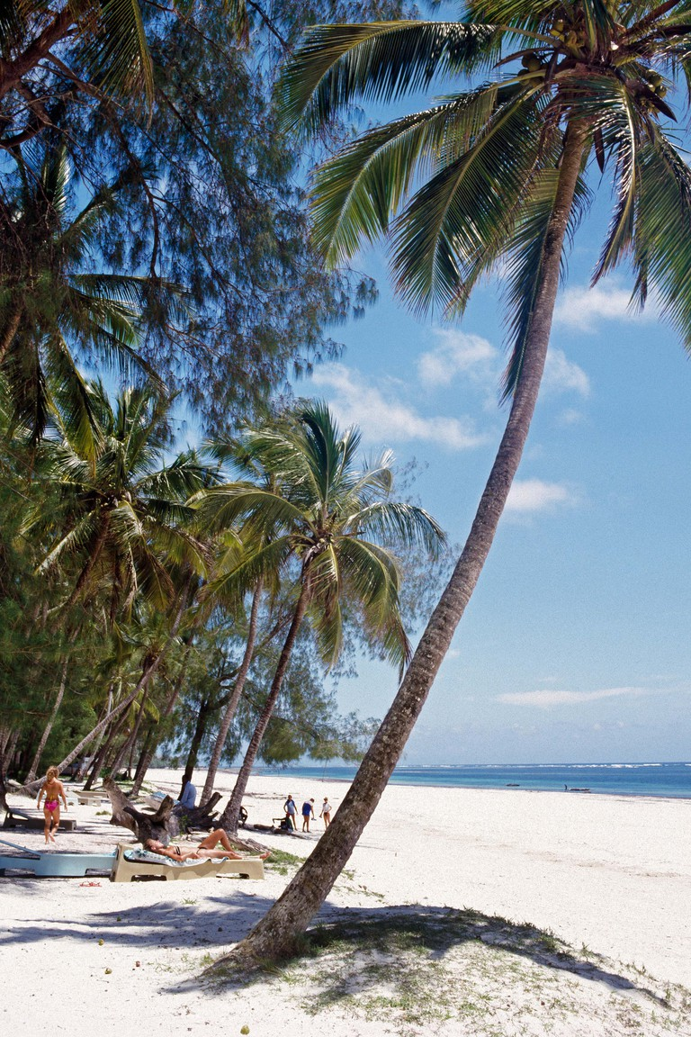 Africa, Kenya, Kwale District, Diani Beach. White sands and coconut palms at Diana Beach, south of Mombasa
