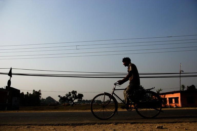 Man on bicycle, Nepalgunj, Nepal.