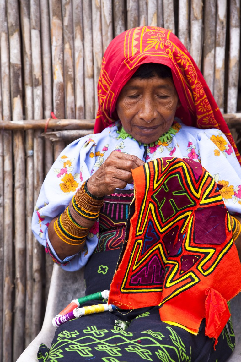Kuna woman sewing a mola, San Blas Islands, Panama, Central America