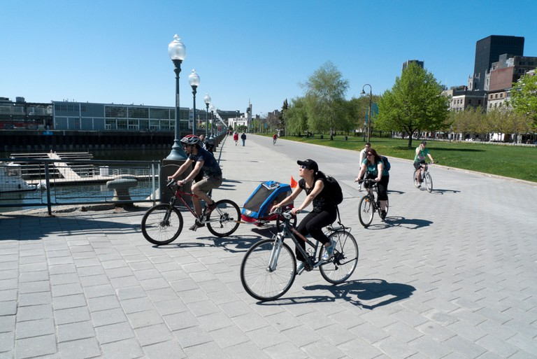 People cycling along the Lachine Canal loop waterfront bike trail Montreal Quebec Canada    KATHY DEWITT