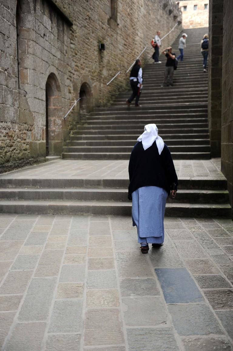 Back view of a nun at Mont Saint Michel