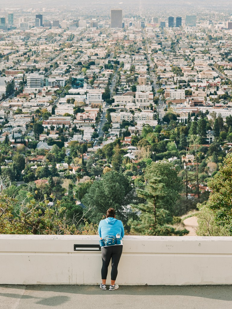 A woman observes Los Angeles from the Griffith Observatory
