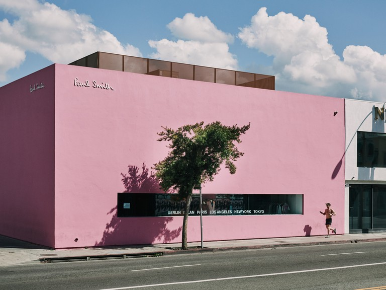 A man runs in front of the Paul Smith store on Melrose Avenue in West Hollywood