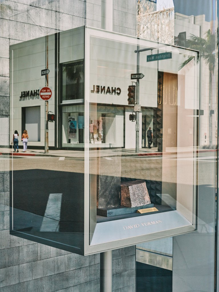The Chanel store is reflected in the empty David Yurman window display on Rodeo Drive in Beverly Hills