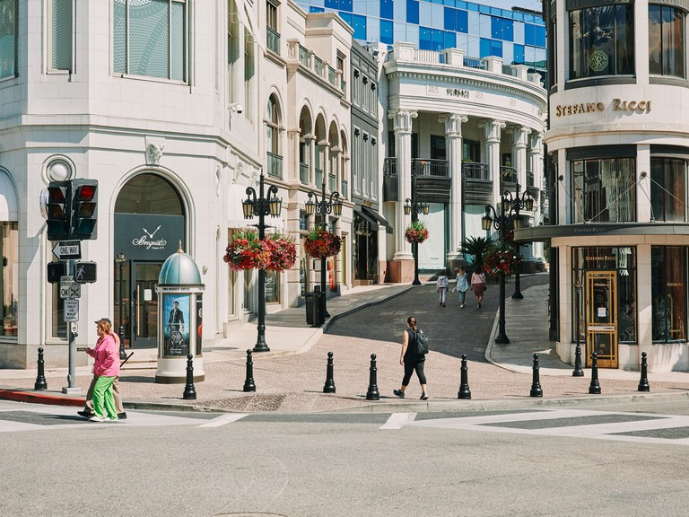 People walk down Rodeo Drive in Beverly Hills